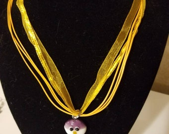 Owl on golden corded necklace