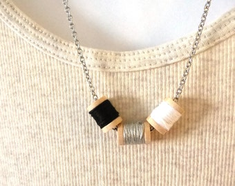 Tiny thread spool necklace, jewelry for sewers, spool necklace,