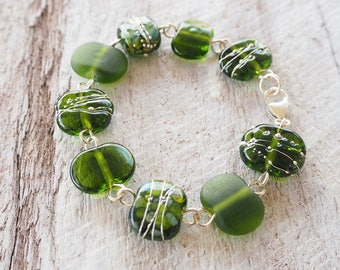 Green beaded bracelet. Handmade recycled glass beads made from a champagne bottle. Great colour, sparkly, perfect for day or night.
