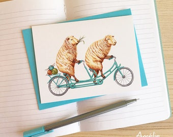 Sheeps on blue tandem bicycle card