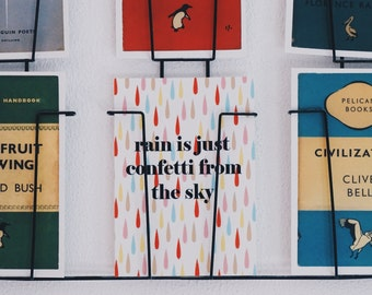 Rain is just confetti from the sky postcard