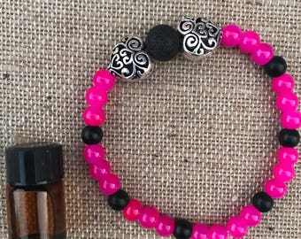 Beaded aromatherapy bracelet with a mini essential oil