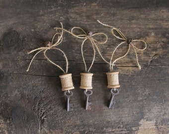 Set of 3 Rustic Wood Spool Ornaments With Rusty Bells, Skeleton Keys and Mother of Pearl Buttons