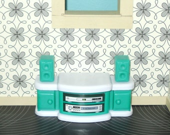 Miniature dollhouse green and white plastic stereo cabinet