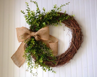 Boxwood wreath with large burlap bow.  boxwood wreath. wreath for door. fall wreath. fall door wreath. wreath for fall. fall decor. wreath
