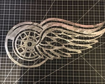Wings Metal Logo