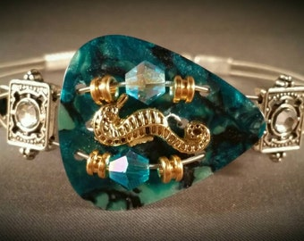 "Guitar pick and guitar string bracelet ""Teal Seahorse"""