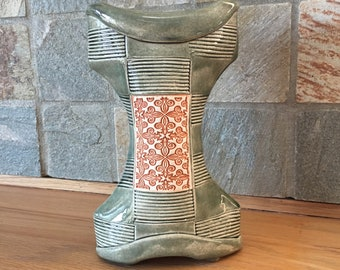Green and orange textured vase