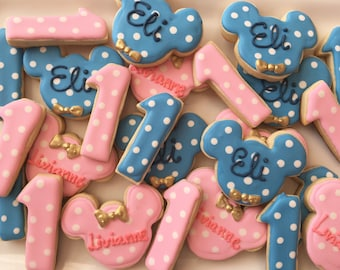 1 dzn. Blue and pink minnie and Mickey Mouse cookies for twin birthday party. Pink and gold and blue bow tie for mickey!
