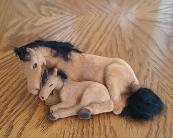 Vintage Brown flocked mother an foal laying down