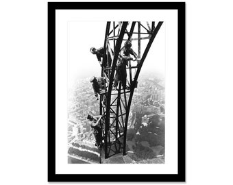 Black and white photo of the painters of the Eiffel Tower in 1936