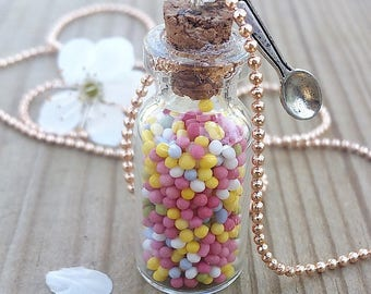 Necklace glass vial filled with candy