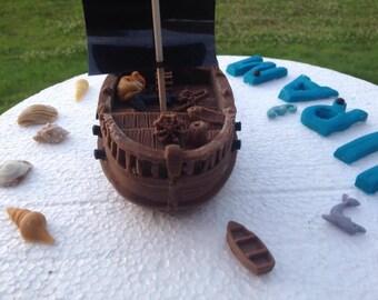 Edible fondant pirate ship, sea shells, sea creatures and name and age