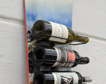 shreD, an upcycled snowboard wine rack, could be that missing design flair for your mountain chalet, winter cabin or ski condo by upCyD