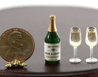 Green Bottle of Champagne with 2 Filled Glasses