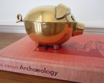 Round brass pig trinket box.  Brass pig.
