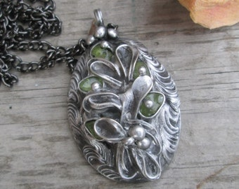 metal  pendant with peridot