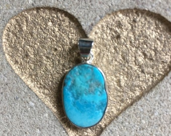 Sleeping Beauty Turquoise and Silver pendant.