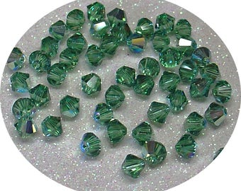 SWAROVSKI CRYSTAL BICONE ERINITE AB 4MM BEAD