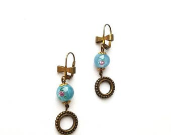 Pearl earrings in blue flower