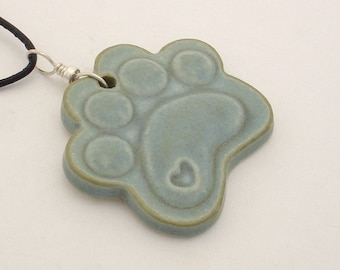 Light teal blue paw print shaped pendant (JTBL-P005-1)