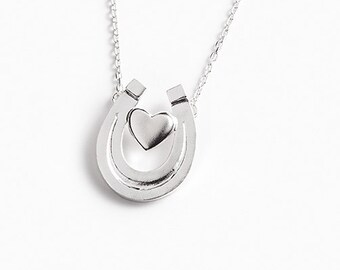 "Equestrian necklace ""The heart inside the horseshoe open to the sky"""
