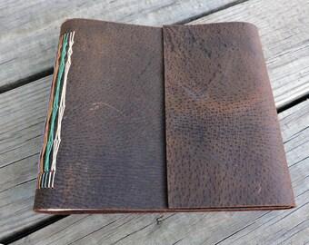 Hand bound book leather flap snowshoe stitch sketchbook journal