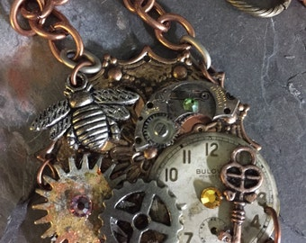 STEAMPUNKALICIOUS...pendant..collage..watch parts..gears..key..bee..mixed metals..original..ooak..handmade
