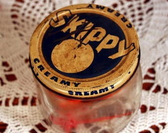 Skippy peanut butter jar filled with retro plastic drink markers-very old pantry jar-animal drink tags