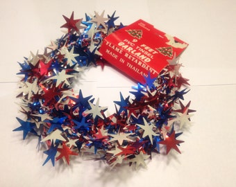 9 feet of red, white, blue tinsel garland (A6)