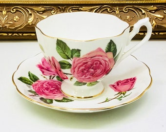 Queen Anne cabbage rose teacup and saucer artist signed.