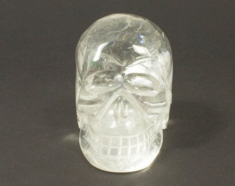 Quartz Crystal Skull with rainbows  -  carved in Brazil   -  reduced price