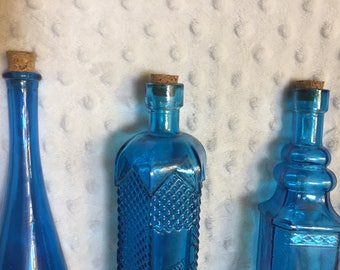 Blue detailed glass bottle set with cork tops