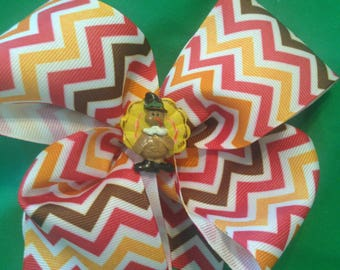A newly made fall colored chevron bow with or without turkey, 1 3/4 inch snap lined clip