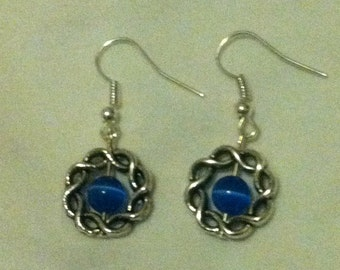 Antique Silver Celtic knot earrings with blue catseye beads.