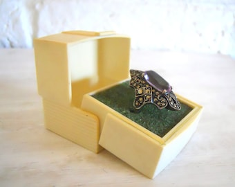 Vintage Lucite ring box circa 1960's cube shaped with a hing top with crown detail