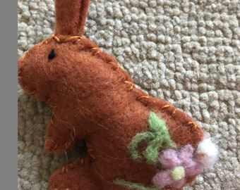 Small felt rabbit with felted flower pattern