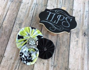Green and black rosette clip & headband