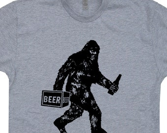Bigfoot Drinking Beer T Shirt Funny Bigfoot Shirts Saying Slogans Sasquatch Tee Shirt Yeti Funny T Shirt UFO Aliens Loch Ness Monster Tees