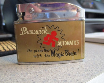 1960's slim line advertisment lighter, Brunswick bowing alley