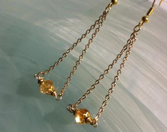 Simple and bohemian earrings, with a faceted citrine on gold plated chain