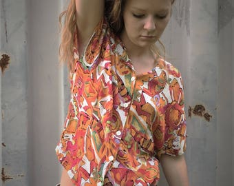 Vintage 90's bright and funky abstract print button-down short sleeved shirt...