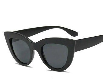 Wide matte black cateye sunglasses