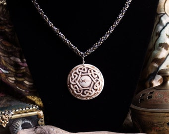 Handmade chainmaile necklace with relief carved porcelain Celtic knot pendant