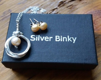 ladies handmade sterling silver and peach pearl, stud earrings and necklace set free uk shipping