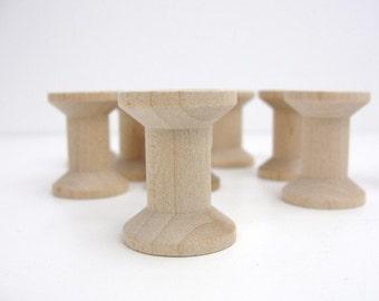 """12 Wooden spools 1 1/8"""" tall"""