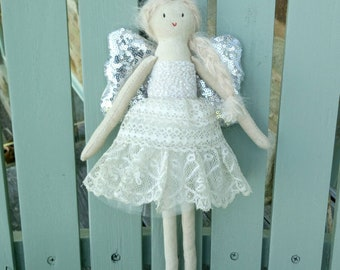A handmade angel or fairy in a vintage lace skirt