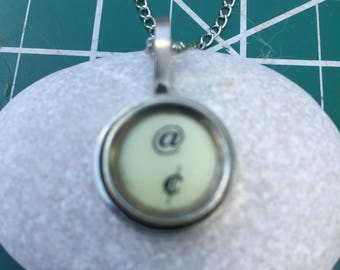 Pound and cent Typewriter key pendant. Black on off white