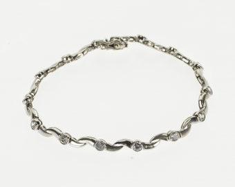 "14K Cubic Zirconia Inset Wavy Curvy Link Tennis Bracelet 6.75"" White Gold"