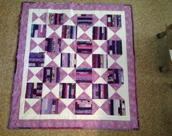 Purple scrappy baby quilt